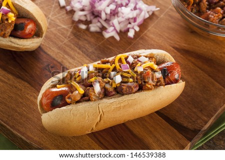 Homemade Hot Chili Dog with Cheddar Cheese and Onions - stock photo