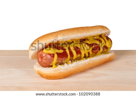 Homemade hot dog on a wooden board