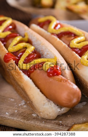 Homemade Hot Dog with ketchup and mustard on rustic wooden background - stock photo