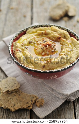 Homemade hummus with seed crackers - stock photo