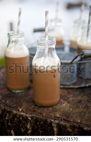 Homemade ice coffee with paper straws - stock photo