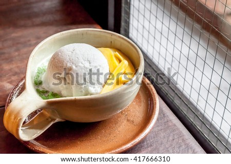 Homemade ice cream gelato in a bowl with Thai style topping in the shop - stock photo