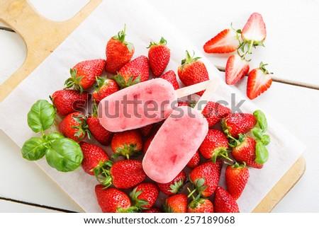 Homemade ice cream pops with fresh berries - stock photo