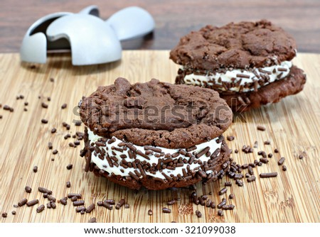 Homemade ice cream sandwiches with chocolate cookies, vanilla ice cream and nonpariels