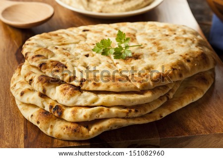 Homemade Indian Naan Flatbread made with Whole Wheat - stock photo