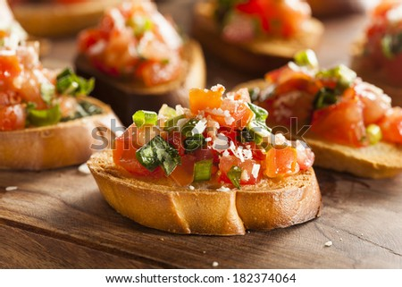 Homemade Italian Bruschetta Appetizer with Basil and Tomatoes - stock photo