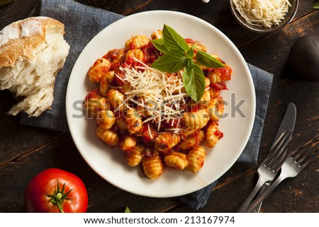 Homemade Italian Gnocchi with Red Sauce and Cheese - stock photo