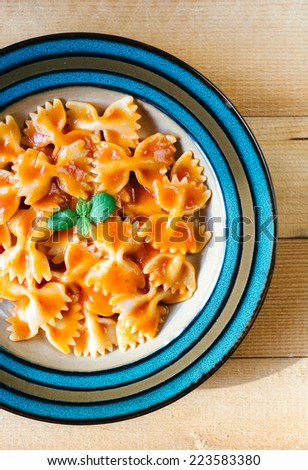 Homemade Italian pasta with tomato sauce in the plate,selective focus  - stock photo