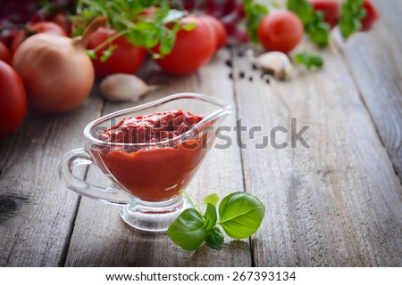 Homemade ketchup and ingredients - stock photo