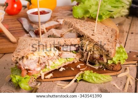 Homemade Leftover Thanksgiving Dinner Sandwich. - stock photo