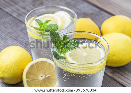 Homemade lemonade with fresh lemon and mint - stock photo