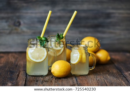 Homemade Lemonade With Mint And Ice Mason Jars On A Rustic Wooden Background