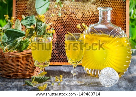 Homemade liqueur made of honey and lime - stock photo