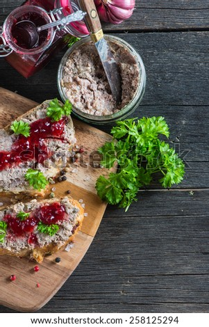 homemade liver pate on wooden table from above - stock photo