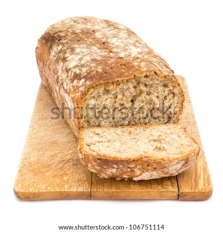 Homemade loaf of bread on plank against white background - stock photo