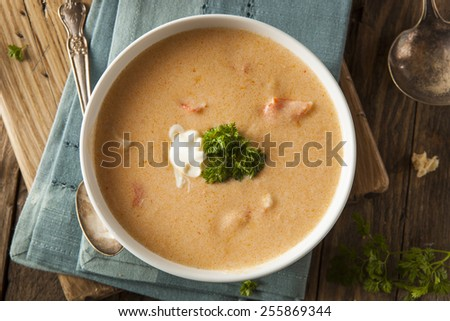 Homemade Lobster Bisque Soup with Cream and Parsley - stock photo