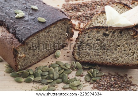 Homemade low carb gluten-free almond flour bread with pumpkin and flax seeds. - stock photo