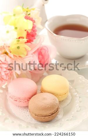 homemade macaron on elegant dish with English tea on background - stock photo