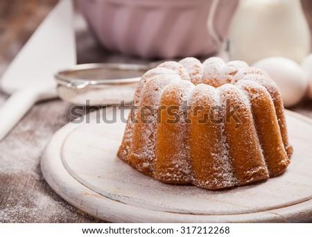 Homemade marble cake with baking utensils - stock photo