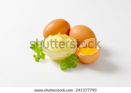 Homemade mayonnaise with broken eggs - stock photo