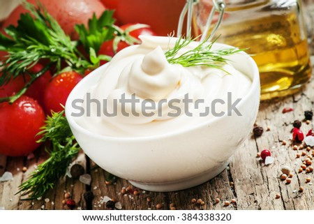 Homemade mayonnaise with chicken eggs and mustard oil, selective focus - stock photo