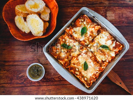 Homemade Meat lasagna on wooden table, selective focus. - stock photo