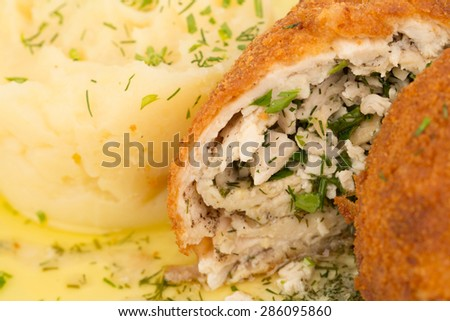 homemade meat patties (zrazy) stuffed with delicious fillings and mashed potatoes closeup - stock photo