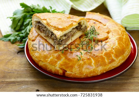 homemade meat pie with thyme for lunch