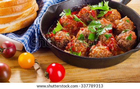 Homemade Meatballs with  Sauce and herbs. Selective focus