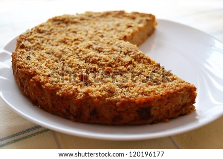 Homemade millet pie mixed with pumpkin and onion in white dish
