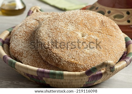 Homemade Moroccan semolina bread in a basket  - stock photo