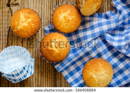 Homemade muffins on a wooden board top view - stock photo