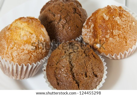 Homemade muffins sprinkled with sugar and white background