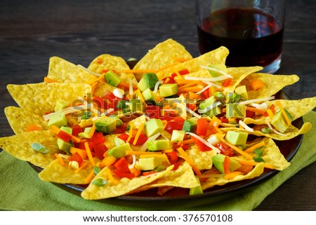 Homemade nachos with cheese and vegetables