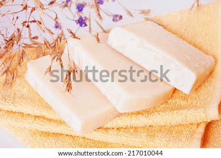 Homemade natural soaps on terry towels - stock photo