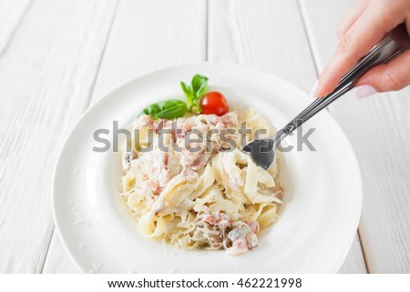 Homemade noodles with bacon and cheese eating, free space. Traditional Italian cuisine concept