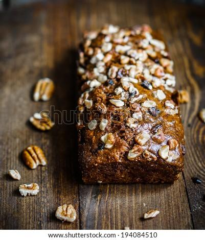 Homemade nut cake on wooden background - stock photo