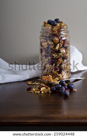 Homemade nut granola in a glass jar - stock photo