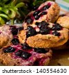 Homemade oatmeal cookies fresh out of the oven with blackberry, closeup - stock photo