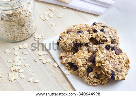 Homemade oatmeal cookies on a wooden kitchen table. - stock photo
