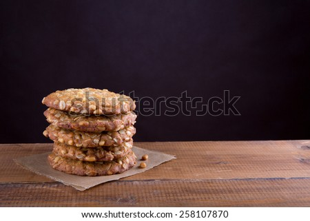 Homemade oatmeal cookies with pine nuts.  - stock photo