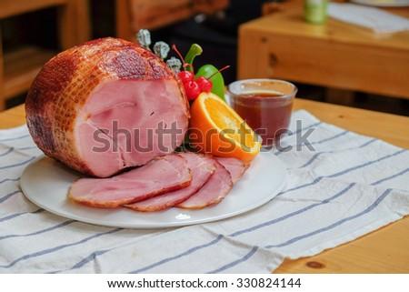 Homemade of Sliced Honey Gammon Ham with Orange, Cherry, Sweet Pepper and Honey Sauce for Festive dinner, Christmas dinner, Holiday table, Thanksgiving day celebration  - stock photo