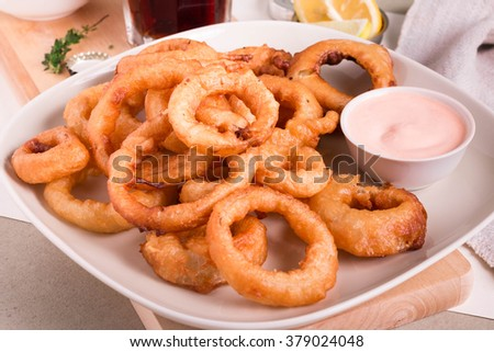 Homemade Onion Rings with Blooming Sauce. Beer Battered Onion Rings. Selective focus.