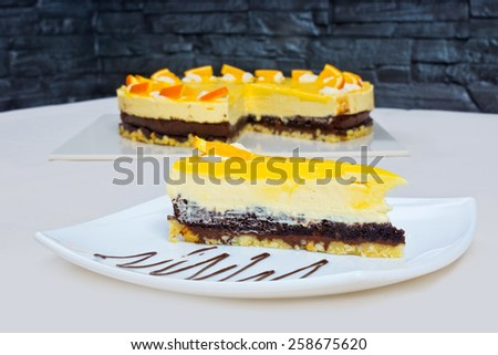 Homemade orange cake cut piece on the plate - stock photo