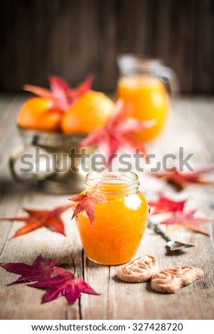 Homemade orange jam in a glass jar