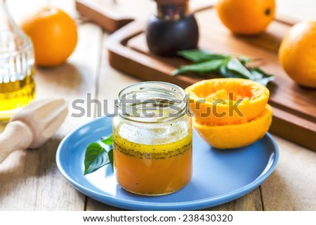 Homemade Orange salad dressing with poppy seed - stock photo