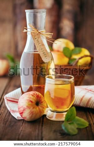 Homemade organic apple cider, ficus on the bottle - stock photo