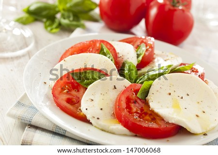 Homemade Organic Caprese Salad with Tomato and Mozzarella - stock photo