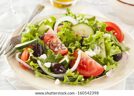 Homemade Organic Greek Salad with Tomato, Olives, and Feta Cheese - stock photo