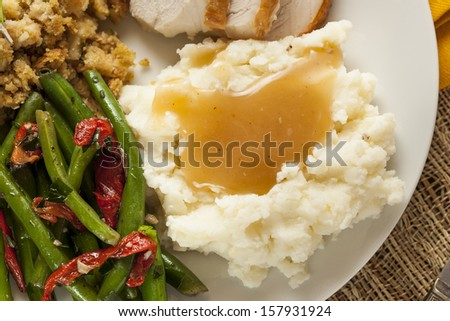 Homemade Organic Mashed Potatoes with Gravy for Thanksgiving - stock photo